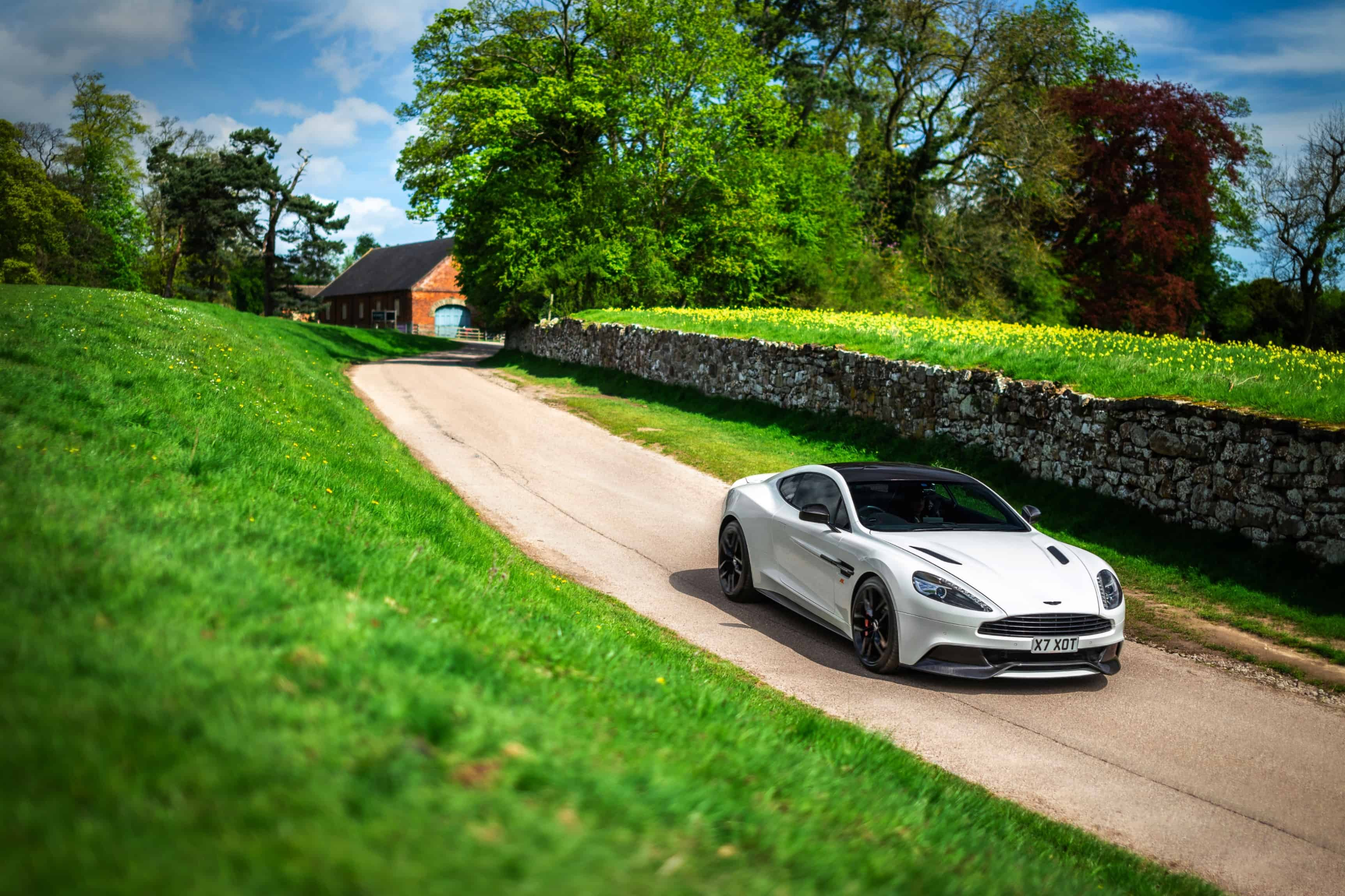 Aston Martin Vanquish S driving through Countryside