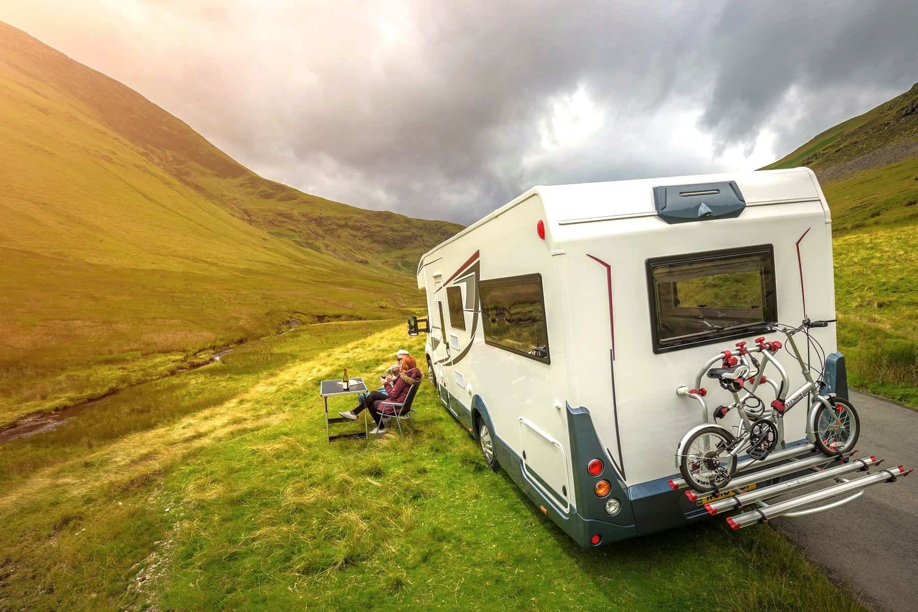 Motorhome Couple outside_ View of Bike
