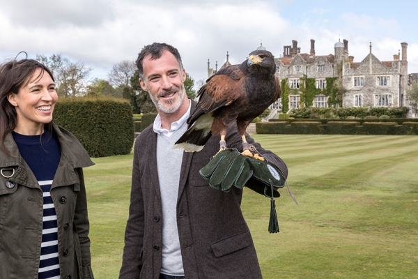 Couple with a falcon on the grounds of Champneys Spa Eastwell Manor.