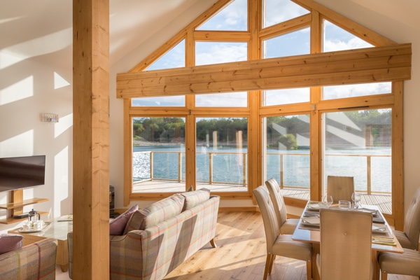 View looking out of a luxury glass fronted lodge.