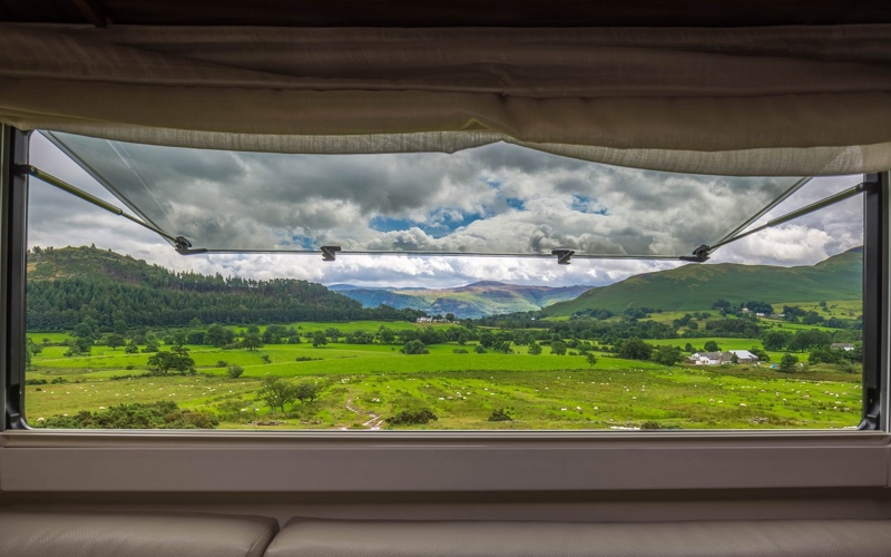 View over the lake district greenery from Motorhome window.