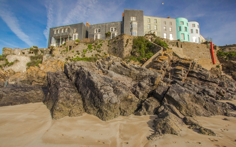 Old architectural buildings on north Wales beach.