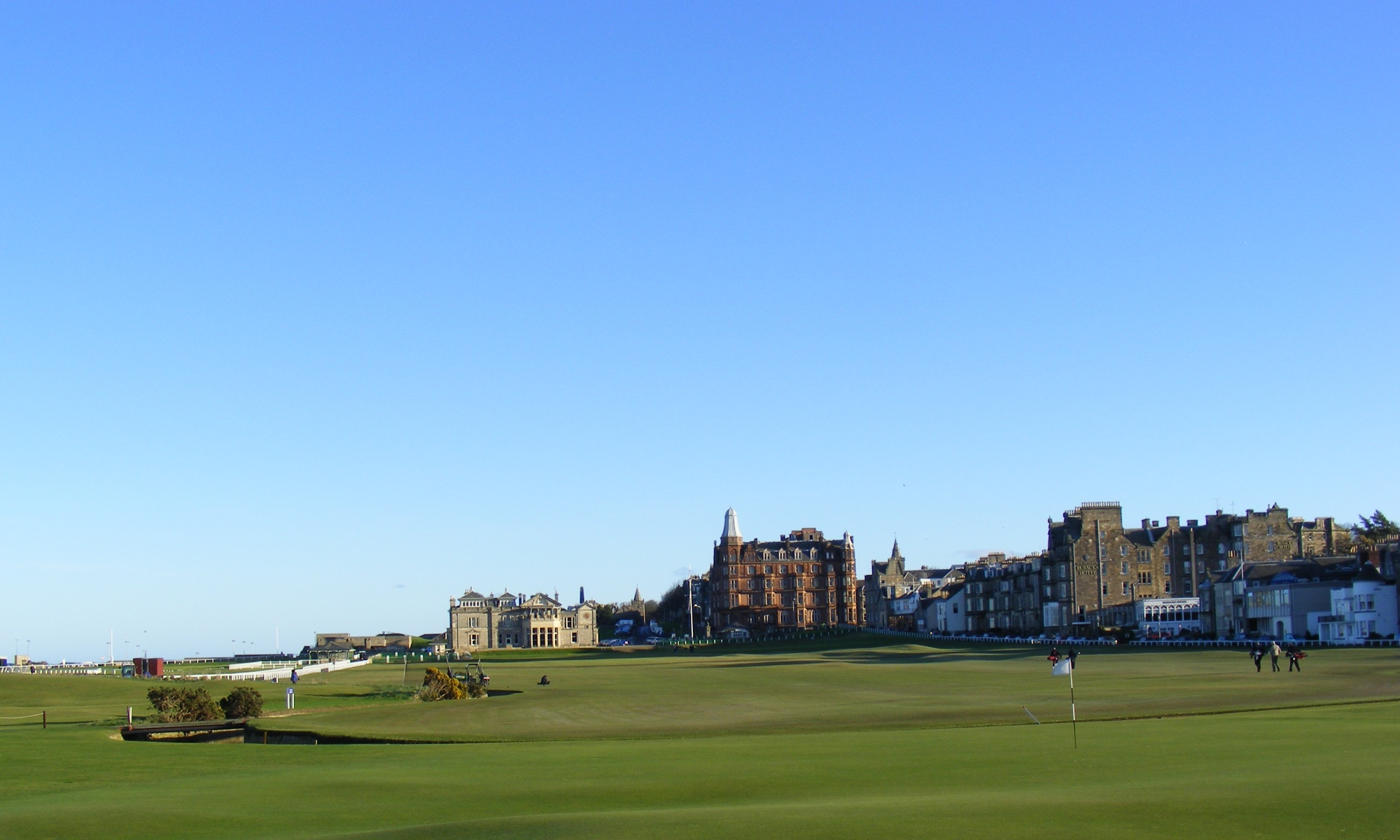 View over a golf green towards St. Andrews in Scotland.