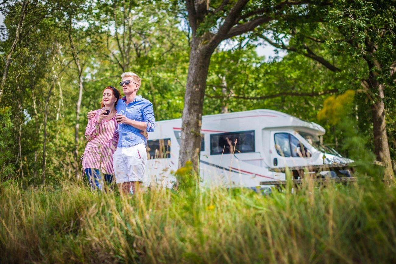 Couple in front of Motorhome