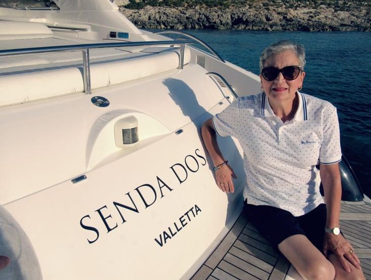 Dee Slight sitting on Sunseeker motor yacht bathing platform in Malta.